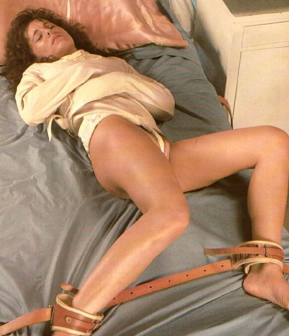 Giving blowjob girl strapped to bed naked black